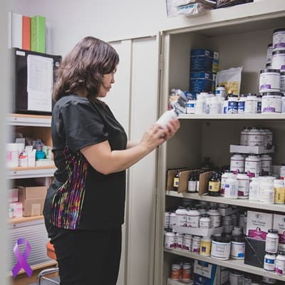 SCNM Sage | women looking at a pill bottle